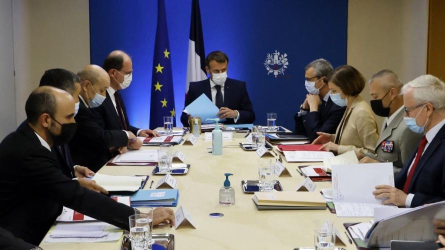 Emmanuel Macron et des membres du gouvernement - LUDOVIC MARIN / AFP